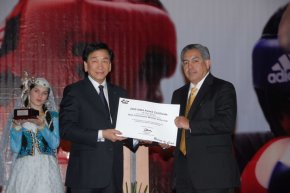 Ray Silvas (right) is seen being given an award for Best R/J Commission Member of the Year by the President of AIBA, Dr. C.K. Wu (left).