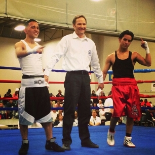 Marshall Sanchez from Houston in red trunks wins opening bout of 2013 Nationals in Spokane Wa, 1st bout without headgear since 1984.  Sanchez trains out of Lopez Boxing Gym in Baytown.