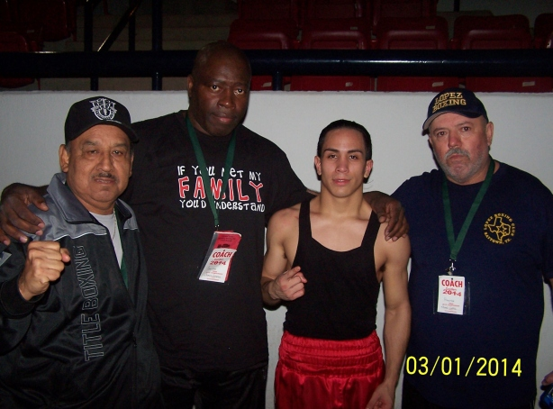 (left to right) Gulf President Juan Moya, Gulf Coach James Johnson, Gulf 114 lbs Champion Marshall Sanchez, Gulf Coach Juan Lopez