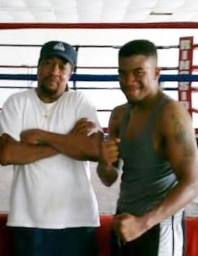 Coach Cliff Miles with boxer Jhaquis Davis