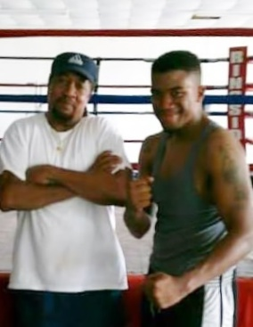 Coach Cliff Miles with boxer Jhaquis Davis